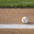 Baseball on base path with grass infield — Stock Photo