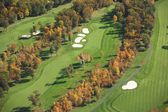Aerial view of golf course in autumn — Stok fotoğraf