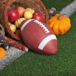 College style Football with a cornucopia on grass field — Stock Photo