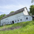 Old, dilapidated white barn in the midwest — Stock Photo