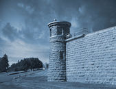 Guard tower at corner of high prison wall — Stok fotoğraf