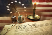 US Constitution with quill pen, glasses, candle, ink and flag — Stock Photo