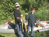 Smartphone picture of two boys showing their catch of walleyes — Stock Photo