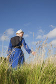 Low angle view of Amish girl walking in a field — Stock Photo