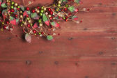 Christmas wreath on red grunge wood background — Stock Photo