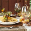 Fall dining place settings on rustic table and wall — Stock Photo #51137447