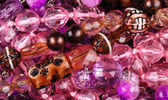 Background from various pink jewellery — Stok fotoğraf