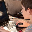 Boy and home computer — Stock Photo