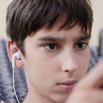 Teen listens music through headphones — Stock Photo