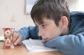 Boy doing homework — Foto de Stock