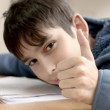 Boy doing homework — Stok fotoğraf