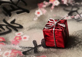 Gift on the fabric — Stock Photo