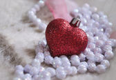 Glass heart and beads — Stock Photo