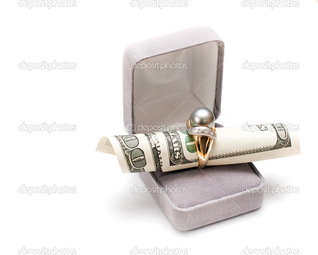 Hundred dollars and golden ring in a box — Stock Photo #13427176