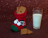 Christmas sock with Cookies and milk — Stock Photo