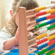 Little Girl with abacus — Stock Photo #18732397