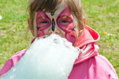 Ittle girl with cotton candy — Stock Photo