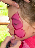 Child preschooler with face painting. Make up. — Stock Photo