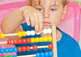 Little Girl with abacus — Stock Photo