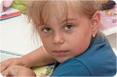 Brunette little girl reading a book — Stock Photo