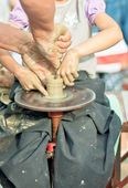 Hands working on pottery wheel — Foto Stock