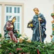Christmas nativity scene with three Wise Men presenting gifts to baby Jesus, Mary & Joseph. — Stock Photo