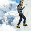 Man climbing on icefall in winter mountains — Stok fotoğraf