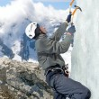 Man climbing on icefall in winter mountains — Stock Photo