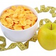 Green apple, bowl of cornflakes and measuring tape. — Foto de stock #23892177