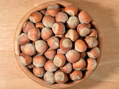 Hazelnuts in a wooden bowl — Stock Photo