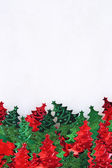 Confetti in the form of Christmas trees — Stock Photo