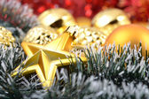 Gold star and Christmas balls — Stock Photo