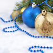 Christmas balls and garland on a spruce branch — Stock Photo #31043829