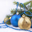 Christmas balls and garland on a spruce branch — Stock Photo #31191487