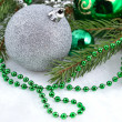 Stock Photo: Christmas balls and garland on a spruce branch