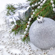 Christmas decorations on a spruce branch — Stock Photo #31234805