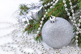 Christmas decorations on a spruce branch — Stock Photo