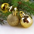 Christmas balls on a spruce branch — Stock Photo #32032749