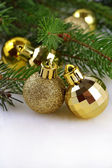 Christmas balls on a spruce branch — Stock Photo