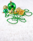 Golden and green Christmas decorations — Stock Photo