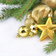 Gold star and Christmas decorations — Photo