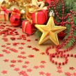 Gold star and Christmas decorations — Stock Photo