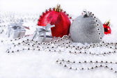 Silver and red Christmas decorations — Stock Photo