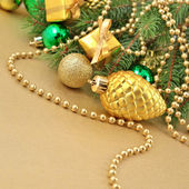Gold bump and Christmas decorations — Stock Photo