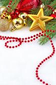 Goldstern und weihnachtsschmuck — Stockfoto