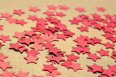 Confetti in the form of red stars — Stock Photo