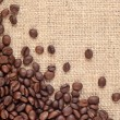 Coffee beans in a sacking background — Stock Photo