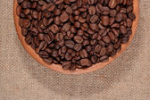 Coffee beans in a wooden bowl — Stock Photo