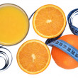 Oranges, glass of orange juice and measuring tape — Stock Photo #36808661