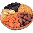 Stock Photo: Various dried fruits in wicker bowl